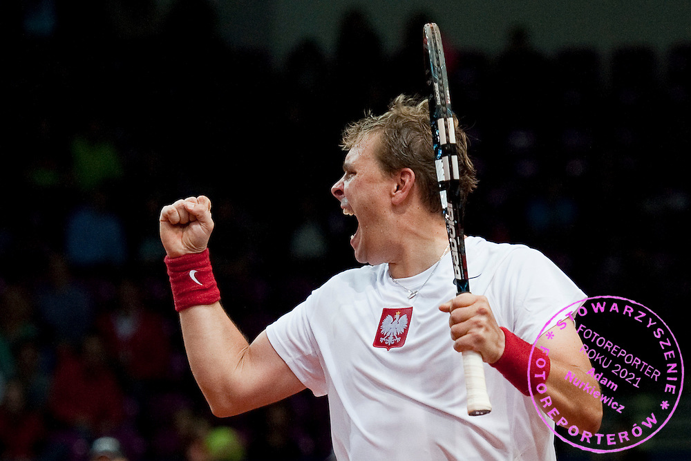 Marcin Matkowski of Poland celebrates victory after men's double during the BNP Paribas Davis Cup 2013 between Poland and Australia at Torwar Hall in Warsaw on September 14, 2013.<br /> <br /> Poland, Warsaw, September 14, 2013<br /> <br /> Picture also available in RAW (NEF) or TIFF format on special request.<br /> <br /> For editorial use only. Any commercial or promotional use requires permission.<br /> <br /> Photo by &copy; Adam Nurkiewicz / Mediasport