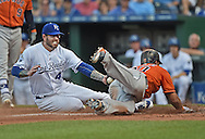 Kansas City Royals pitcher Peter Moylan (47) tags out Houston Astros base runner Carlos Gomez (30) attempting to score on a wild pitch during the third inning at Kauffman Stadium.