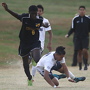 Newark FC forward Daniel Addison (9) pushes Delcastle midfielder Salvador Munoz (2) from behind during a regular season soccer match between Newark and Delcastle Thursday, Oct. 22, 2015 at Delcastle in Wilmington.