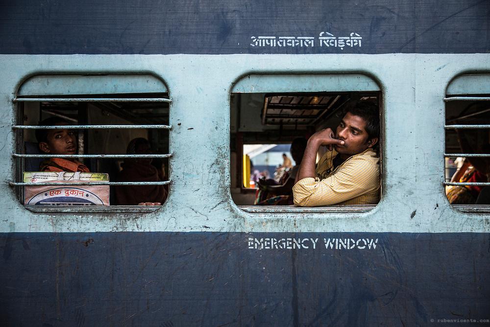 Man by the train window. Varanasi, India