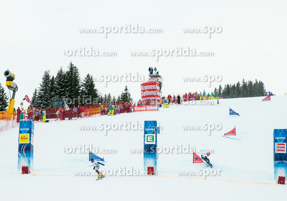 Winner Andrey Sobolev of Russia  and second placed Zan Kosir of Slovenia at finish line during the Final of the Men's Parallel Giant Slalom at FIS World Championships of Snowboard and Freestyle 2015, on January 23, 2015 at the WM Piste in Lachtal, Austria. Photo by Vid Ponikvar / Sportida