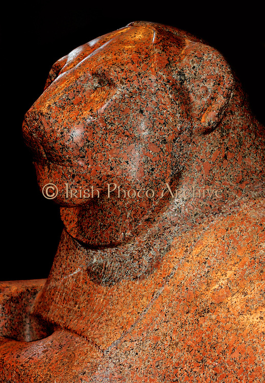 Prudhoe Lion, Eighteenth Dynasty (approx. 1400 BC) from Gebel Barkal in the Sudan. Ancient Egyptian figure of a lion made from red granite, one of a matching pair. Originally from Temple of Soleb in Nubia.
