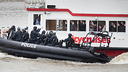 © Licensed to London News Pictures.19/03/2017.London, UK. Hostages hold up their hands as armed police arrive to board a cruise boat during an ant-terrorist training exercise on The River Thames in London. It is the first time that an exercise of this type has taken place on the river.Photo credit: Peter Macdiarmid/LNP