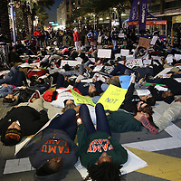 "Protesters gather outside of the Amway Arena, home of the Orlando Magic, to perform a ""die in"" to rally against police brutality on Wednesday, December 10, 2014 in Orlando, Florida.  Since a Staten Island grand jury decided last week not to bring any charges against a white officer who was seen on video using a chokehold on Eric Garner, and other use of questionable force issues by the police across the country, the Orlando protesters wanted to represent the city of Orlando. (AP Photo/Alex Menendez)"
