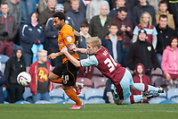 Football - 2012 / 2013 Championship - Burnley vs. Wolverhampton Wanderers<br /> Ben Mee of Burnley clings on to Wolves' Jermaine Pennant at Turf Moor