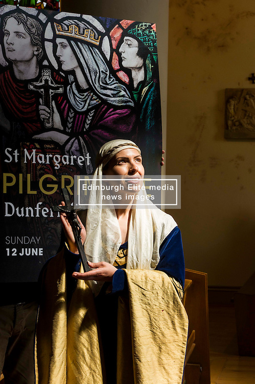 Pictured: Actress Katie Milne, dressed as St Margaret.<br /> <br /> Today Archbishop Leo Cushley was joined by 'St Margaret of Scotland' to unveil the publicity poster being sent to every Catholic parish in the country to advertise this summer's St Margaret's Pilgrimage, which will take place on 12 June in Dunfermline. Actress Katie Milne, dressed as St Margaret, joined the Archbishop in Edinburgh to launch the poster.<br /> <br /> Ger Harley   EEm 10 May April 2016