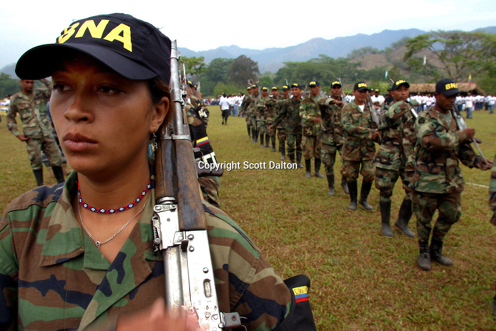 Members of the paramilitary group Bloque Norte, or Northern Block, march in formation before a disarmament ceremony in Chimila, in northern Colombia, on March 8, 2006. An estimated 24,000 paramilitary members have turned in their weapons as part of a government negotiated peace deal. But some are skeptical if the government plan will really work and if the paramilitary members will be successful in their transformation to civilian life. (Photo/Scott Dalton)