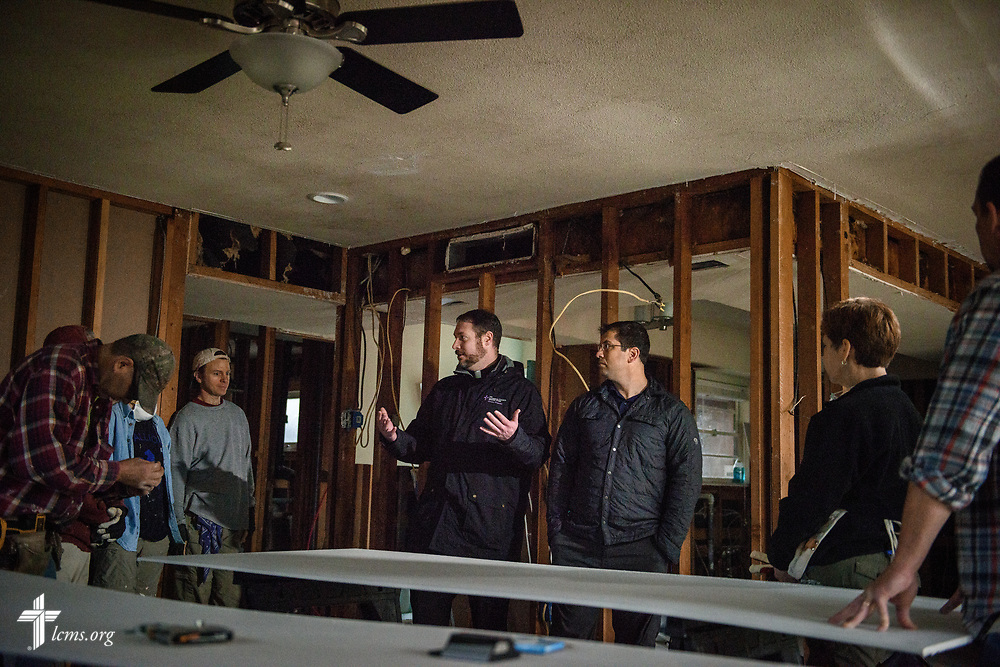 The Rev. Michael Meyer (hands up), manager of LCMS Disaster Response, and the Rev. Ross Johnson, director of LCMS Disaster Response, greet volunteers from Saint Paul Lutheran Church, Mount Prospect, Ill., on Wednesday, Feb. 7, 2018, at a home damaged by Hurricane Harvey in Port Arthur, Texas.  LCMS Communications/Erik M. Lunsford