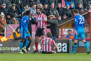 Lincoln City Manager Danny Cowley runs in to hold back Lincoln City Forward Ollie Palmer after he tangles with Grimsby Town Midfielder Mitch Rose (8)  during the EFL Sky Bet League 2 match between Lincoln City and Grimsby Town FC at Sincil Bank, Lincoln, United Kingdom on 17 March 2018. Picture by Craig Zadoroznyj.