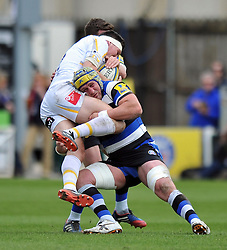 Carl Fearns (Bath) puts in a tackle - Photo mandatory by-line: Patrick Khachfe/JMP - Tel: Mobile: 07966 386802 19/04/2014 - SPORT - RUGBY UNION - The Recreation Ground, Bath - Bath Rugby v Worcester Warriors - Aviva Premiership.