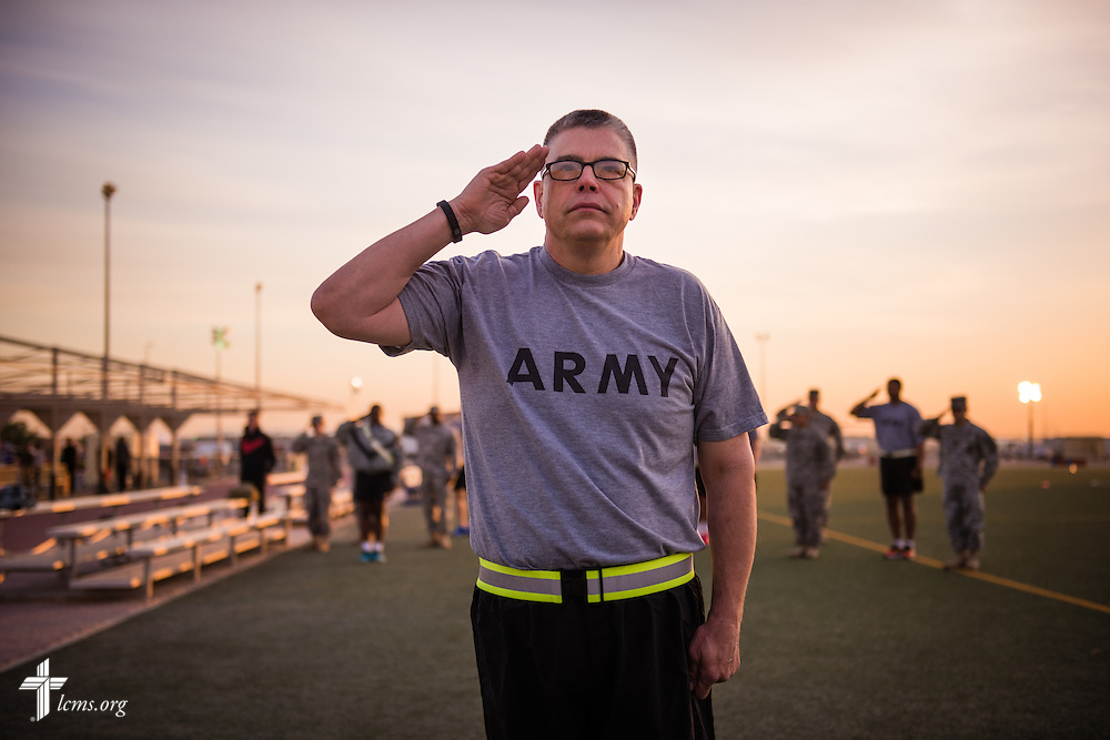 Army Lt. Col Steven Hokana, chaplain, at Camp Arifjan, salutes at dawn on Tuesday, March 24, 2015, in Kuwait. LCMS Communications/Erik M. Lunsford