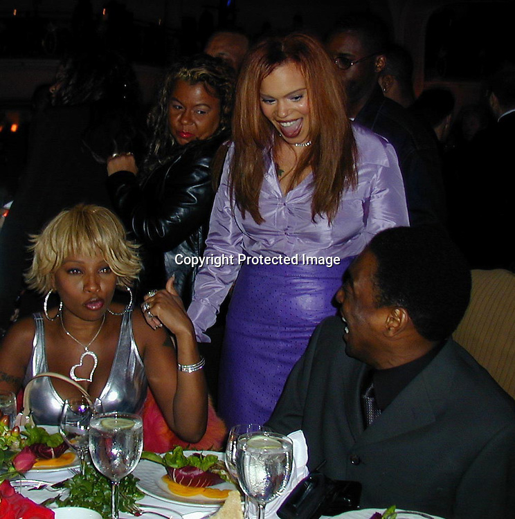 Mary J. Blije, Faiith Evans and friend<br />Arista Records Pre Grammy Bash Hosted By Clive Davis<br />Beverly Hills Hotel<br />Los Angeles, California, USA<br />Tuesday,February 22, 2000<br />Photo By Celebrityvibe.com/Photovibe.com