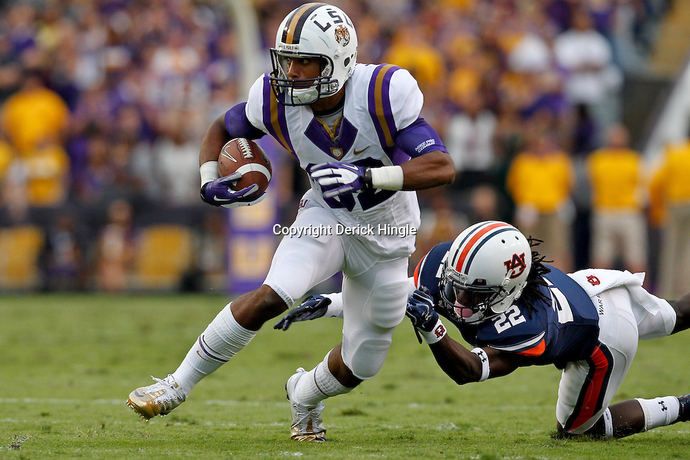 October 22, 2011; Baton Rouge, LA, USA; LSU Tigers wide receiver James Wright (82) escapes a tackle by Auburn Tigers defensive back T'Sharvan Bell (22) during the second half at Tiger Stadium. LSU defeated Auburn 45-10. Mandatory Credit: Derick E. Hingle-US PRESSWIRE / © Derick E. Hingle 2011