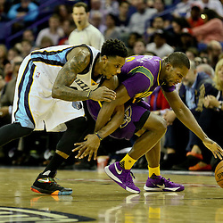 Feb 1, 2016; New Orleans, LA, USA; \New Orleans Pelicans guard Toney Douglas (16) is fouled by Memphis Grizzlies guard Mario Chalmers (6) while scrambling for a loose ball during the second half of a game at the Smoothie King Center. The Grizzlies defeated the Pelicans 110-95. Mandatory Credit: Derick E. Hingle-USA TODAY Sports