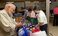 "Abe Dadian, Diane Tinkham, Alexis Albert, Jan Streifer and Mayor Michael Seymour pack up ""Got Lunch"" bags assembly style on Wednesday morning at the Congregational Church in Laconia.  (Karen Bobotas/for the Laconia Daily Sun)"