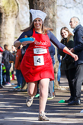 © Licensed to London News Pictures. 28/02/2017. London, UK. CAROLINE WHEELER races against MPs and Lords at the annual Rehab Parliamentary Pancake Race outside the Parliament on Shrove Tuesday, 28 February 2017. Photo credit: Tolga Akmen/LNP