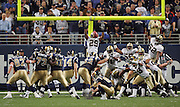 ST. LOUIS - SEPTEMBER 23:  Kicker Jeff Wilkins #14 of the St. Louis Rams kicks a PAT point after try against the New Orleans Saints at the Edward Jones Dome on September 23, 2005 in St. Louis, Missouri. The Rams defeated the Saints 28-17. ©Paul Anthony Spinelli *** Local Caption *** Jeff Wilkins
