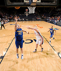 Morehead St. forward Brandi Rayburn (40) shoots past Virginia forward/center Abby Robertson (30).  The Virginia Cavaliers women's basketball team defeated the Morehead State Eagles 88-43 at the John Paul Jones Arena in Charlottesville, VA on February 4, 2008.