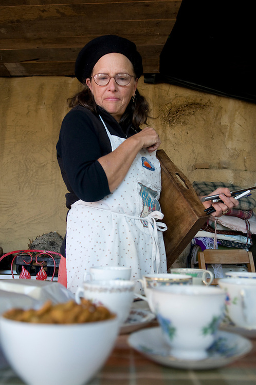 Annie Warmke sets out tea for guests during a workshop at Blue Rock Station.