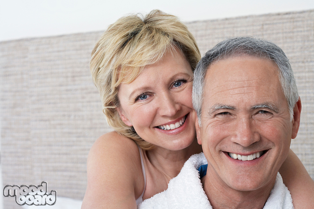 Portrait of middle-aged couple in bedroom close-up