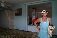 Sharon Cahill, 55, stands in the home that was gutted, but not destroyed, by hurricane Irma on Marco Island, Florida, U.S., September 11, 2017. REUTERS/Bryan Woolston