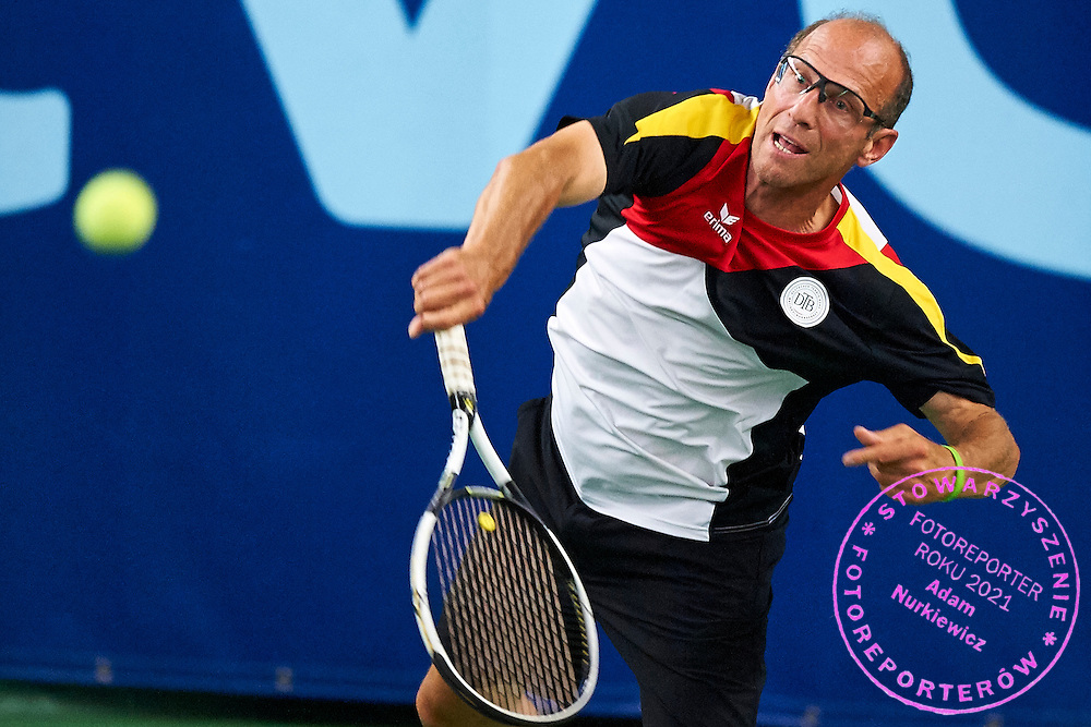 Helsinki, Finland - 2016 June 23: Peter Schreckenberg from Germany in action while team men's Austria Cup (Men 55) match between Germany and Russia during 2016 ITF Seniors World Team Championships at Talin Tenniskeskus on June 23, 2016 in Helsinki, Finland.<br /> <br /> Adam Nurkiewicz declares that he has no rights to the image of people at the photographs of his authorship.<br /> <br /> Picture also available in RAW (NEF) or TIFF format on special request.<br /> <br /> Any editorial, commercial or promotional use requires written permission from the author of image.<br /> <br /> Mandatory credit:<br /> Photo by &copy; Adam Nurkiewicz