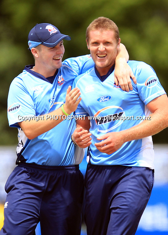 Aces players Colin Munro and Michael Bates celebrate another Pakistan wicket. Twenty20 Cricket, Auckland Aces v Pakistan, Colin Maiden Park, Auckland. Thursday 23 December 2010.Photo: Andrew Cornaga/photosport.co.nz