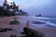 Sunset over the beach at Weligama, on Sri Lanka's southwest coast