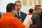 Jeff McCann, an IT Manager for Progressive and a '95 Ohio University alum, looks over Nathan Chernomorets's resume at the College of Business Conference on September 7, 2017.