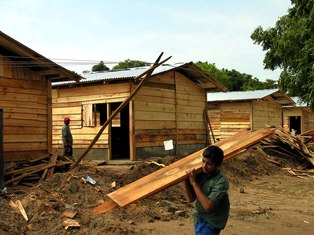 One hundred temporary housing units being constructed by Care Int. for up to 600 people displaced by the 26 December, 2004 tsunami that struck S.E. Asia..Kirinda, Sri Lanka. 21/01/2005.Photo © J.B. Russell
