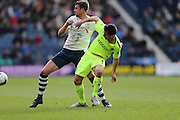 Preston North End Defender Paul Huntington (23) and Brighton striker, Sam Baldock (9) during the Sky Bet Championship match between Preston North End and Brighton and Hove Albion at Deepdale, Preston, England on 5 March 2016.