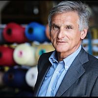 Nella fotografia: il Presidente Paolo Piana ritratto all'interno dello stabilimento di Sandigliano.. Sinterama, azienda di Sandigliano (BI) specializzata nella produzione di fili e filati di poliestere colorati per tessuti utilizzati nell'automotive, arredamento, abbigliamento.