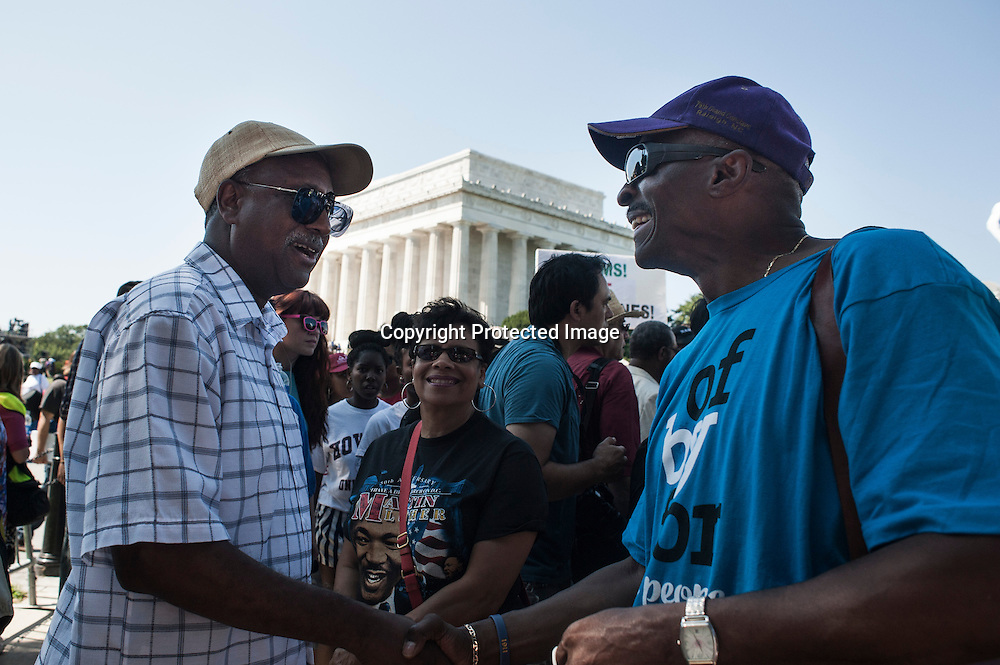 Daniel Brown with wife Cathy of Knoxville speaks with Anthony Spearman of Hickory NC during the 50th Anniversary Of Martin Luther King's March On Washington Commemorated at the Lincoln Memorial in Washington DC on August 24, 2013. Photo by Kris Connor.