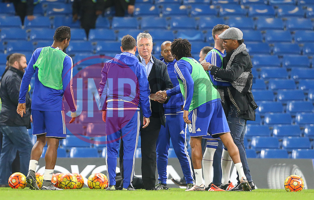 Newly appointed Chelsea Manager, Guus Hiddink ( C ),  and Didier Drogba ( R ) shake hands with the players after the match  - Mandatory byline: Paul Terry/JMP - 07966 386802 - 19/12/2015 - FOOTBALL - Stamford Bridge - London, England - Chelsea v Sunderland - Barclays Premier League