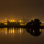 Looking towards the Pandora Pond part of Ahuriri Estuary from the Motorway. Reflections of the lights on the water. Ahuriri Estuary, Napier, New Zealand. September.