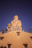 The unusual chimneys and roof of Casa Mila as seen from a window inside the roof cavity in Barcelona, Spain