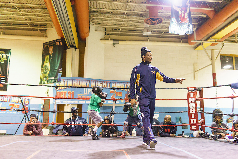 Baltimore, Maryland - January 26, 2017: Coach Calvin Ford circles the ring during sparring practice at the Upton Boxing Club in Baltimore Thursday January 26, 2017.<br /> <br /> <br /> CREDIT: Matt Roth for The New York Times<br /> Assignment ID: