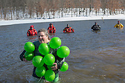 Cheri McCollum, of Albany, Ohio, make her way through Lake Snowden during the Polar Plunge on February 13, 2016. This was McCollum's third time participating in the Polar Plunge. Photo by Emily Matthews