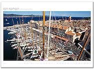 Voiles de Saint-Tropez, St Tropez, France. The mistral is blowing and the racing fleet are held inshore. This shot is taken from the mast of the J Class yacht Velsheda looking over the town across to the Golfe de St Tropez.