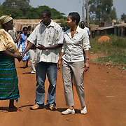 Helene Gayle, President and CEO of CARE greets residents in Siaya district in Western Kenya during a Learning Tours trip to Kenya.