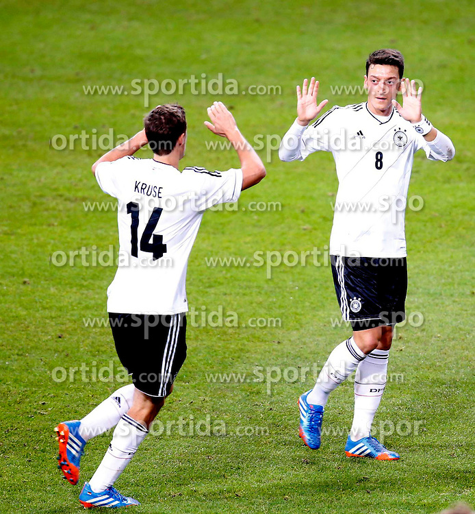 15.10.2013, Friends Arena, Stockholm, SWE, FIFA WM Qualifikation, Schweden vs Deutschland, Gruppe C, im Bild Germany 8 Mesut �zil celebrate 2-1 with Germany 14 Max Kruse // during the FIFA World Cup Qualifier Group C Match between Sweden and Germany at the Friends Arena, Stockholm, Sweden on 2013/10/15. EXPA Pictures � 2013, PhotoCredit: EXPA/ PicAgency Skycam/ Sami Grahn<br /> <br /> ***** ATTENTION - OUT OF SWE *****