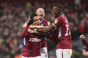 Aston Villa striker (on loan from Lille) Anwar El Ghazi (22) scores a goal and celebrates  5-4 with Aston Villa defender Alan Hutton (21) and Aston Villa striker(on loan from Chelsea) Tammy Abraham (18) during the EFL Sky Bet Championship match between Aston Villa and Nottingham Forest at Villa Park, Birmingham, England on 28 November 2018.