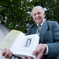 Alexander McCall Smith with his specially presented Scotland Street book, featuring a cutout for a Bertie Pollock's (character in the series) much desired penknife inside. McCall Smith was presented with the book for Scotland Street becoming the longest running serial novel in the world. Pictured at the Edinburgh International Book Festival 2015. Edinburgh, Scotland. 21st August 2015 <br /> <br /> Photograph by Gary Doak/Writer Pictures<br /> <br /> WORLD RIGHTS