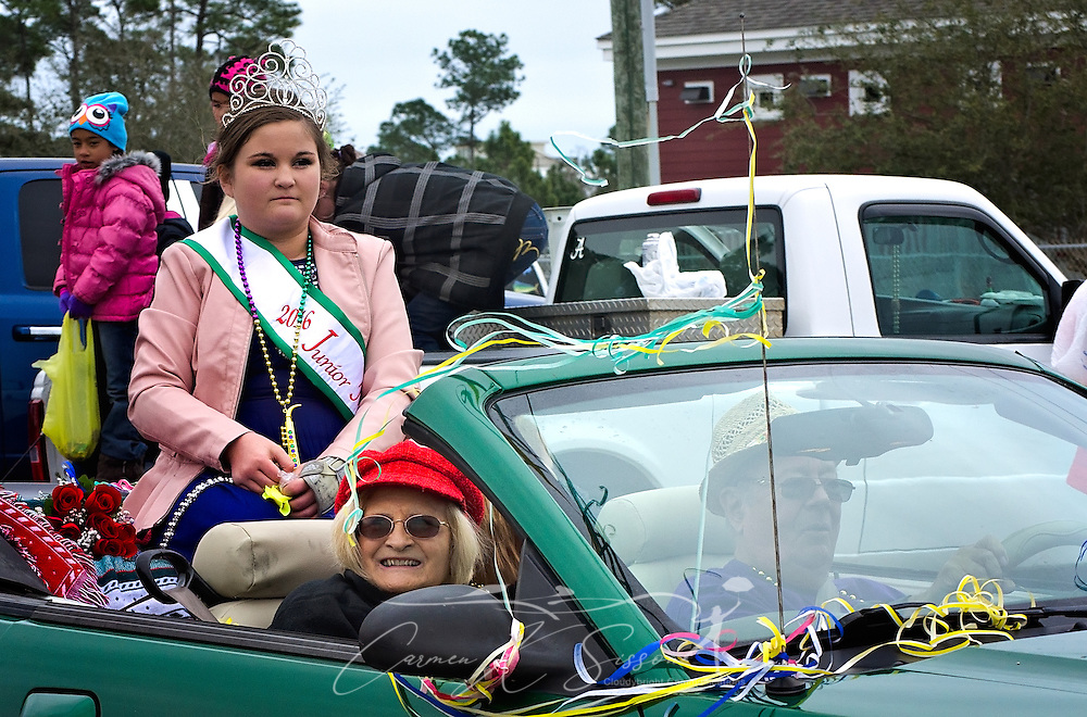 Claire Wagner, 2016 Junior Miss Dauphin Island, rides in the Krewe de la Dauphine Mardi Gras Parade, Jan. 28, 2017, in Dauphin Island, Alabama. (Photo by Carmen K. Sisson/Cloudybright)