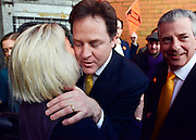 © Licensed to London News Pictures. 27/02/2013. Eastleigh, UK Leader of the Liberal Democrats and Deputy Prime minister Nick Clegg (left) and Liberal Democrat Parliamentary Candidate for Eastleigh, Mike Thornton are greeted when they arrive for a press conference at the Liberal Democrat campaign headquarters in Eastleigh. Campaigning in the weeks ahead of The Liberal Democrats winning the Eastleigh by-election, with the UK Independence Party pushing the Conservatives into third place.. Photo credit : Stephen Simpson/LNP