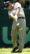Toru Taniguchi of Japan hits his tee shot on the first hole during the first day of the US Open Golf Championship at Winged Foot Golf Club in Mamaroneck, New York Thursday, 15 June 2006.