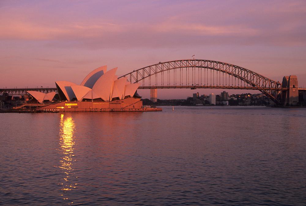Australia, Sydney, Sydney Opera House (built 1973) and Harbor Bridge (built 1932).