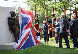© London News Pictures. 17/06/2015. BELGIUM. <br /> His Royal Highnesses The Prince of Wales unveils the magnificent new bronze sculpture featuring two British soldiers, by Vivienne Mallock, which was unveiled as a new memorial to all the British dead.. 200 years since the eve of the Battle of Waterloo, Their Royal Highnesses The Prince of Wales and the Duchess of Cornwall attended a special ceremony at Hougoumont Farm, the Belgian Farm Wellington claimed was instrumental in his victory.  Photo credit: Sergeant Rupert Frere/LNP