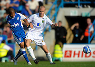Picture by Ady Kerry/Focus Images Ltd.  .26/09/09.Gillingham's Simeon Jackson  challenges Norwich's Jens Berthel Askou during their Coca-Cola League 1 game at the Priestfield Stadium, Gillingham, Kent.