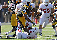 October 22, 2011: Iowa Hawkeyes running back Marcus Coker (34) tries to get over Indiana Hoosiers defensive back Alexander Webb (27) during the first half of the NCAA football game between the Indiana Hoosiers and the Iowa Hawkeyes at Kinnick Stadium in Iowa City, Iowa on Saturday, October 22, 2011. Iowa defeated Indiana 45-24.